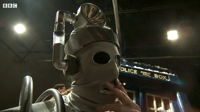 A Cyberman grabs a smoke break on the set of DOCTOR WHO (AN ADVENTURE IN SPACE AND TIME).