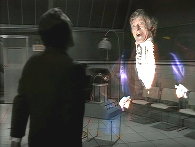 The Master (Roger Delgado) is tormented by visions of the Doctor (Jon Pertwee) in DOCTOR WHO: The Mind of Evil