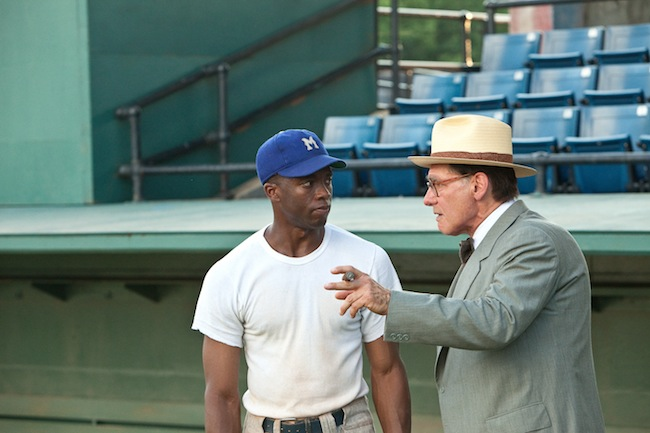 Chadwick Boseman as Jackie Robinson and Harrison Ford as Branch Rickey in 42.