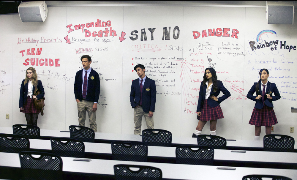 """[L-R] Sammi Hanratty as Siouxsie Hess, Colby Arps as Blane Wilkes, Matthew Frias as Brian Marquez, Sophia Taylor Ali as Faith Jackson, and Erika Daly as Sara Hasegawa in the thriller """"BAD KIDS OF CRESTVIEW ACADEMY"""" a Momentum Pictures release. Photo courtesy of Momentum Pictures."""