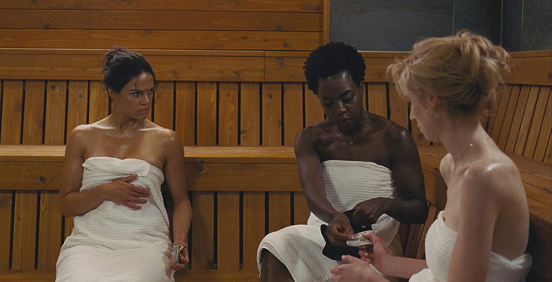 the gals plan a heist in the sauna in WIDOWS
