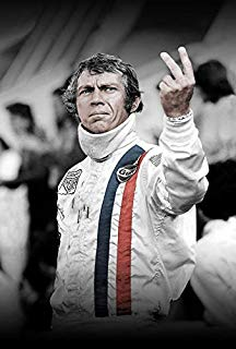 Steve McQueen gives a two-fingered salute.