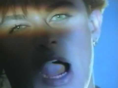 Den Harrow in an 80s'tastic music video