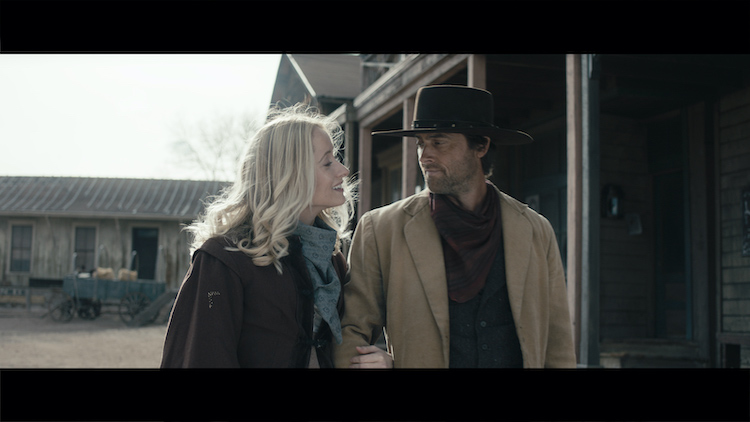[L-R] Danielle Gross as Mary Primm and Stuart Townsend as Jericho Ford in the western/action film, APACHE JUNCTION, a Saban Films release. Photo courtesy of Saban Films.
