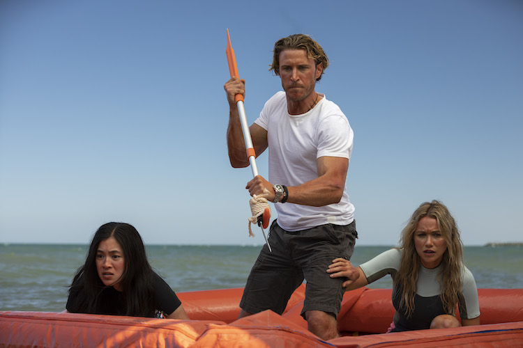 (L-R) Kimie Tsukakoshi as Michelle, Aaron Jakubenko as Charlie and Katrina Bowden as Kaz in the , GREAT WHITE, an RLJE Films and Shudder release. Photo courtesy of RLJE Films and Shudder.