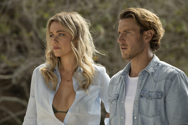 (L-R) Katrina Bowden as Kaz and Aaron Jakubenko as Charlie in the action- adventure/thriller, GREAT WHITE, an RLJE Films and Shudder release. Photo courtesy of RLJE Films and Shudder.