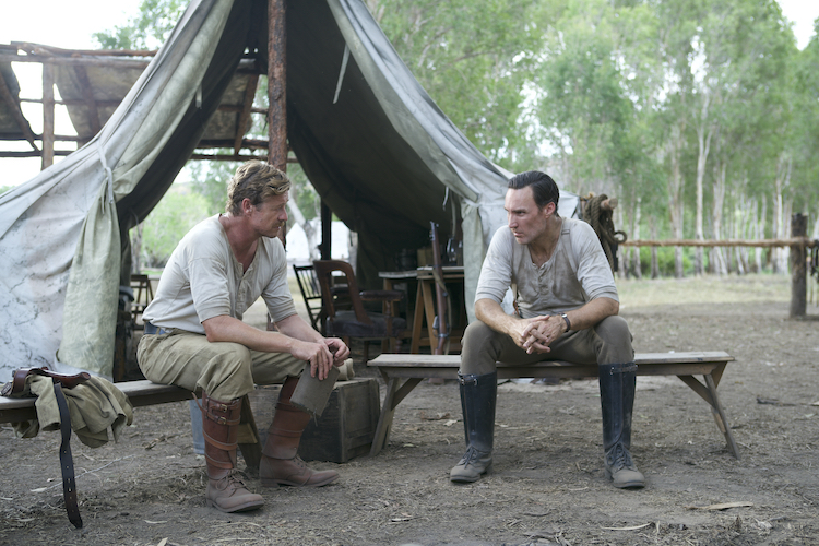 [L-R] Simon Baker as Travis and Callan Mulvey as Eddy in the adventure/drama film, HIGH GROUND, a Samuel Goldwyn Films release. Photo Courtesy of Samuel Goldwyn Films.