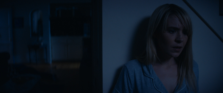 Still from LUCKY, starring Brea Grant as May