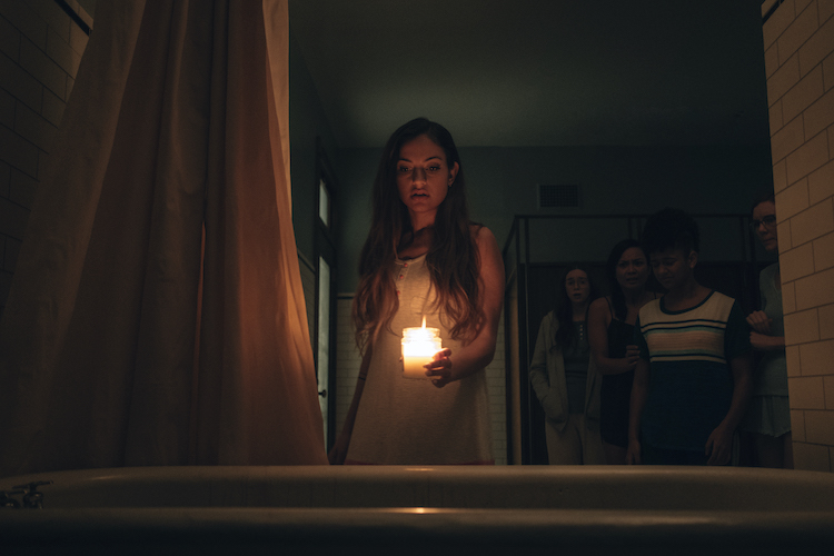 Inanna Sarkis as Alice in the horror SEANCE, an RLJE Films and Shudder release. Photo courtesy of RLJE Films and Shudder.