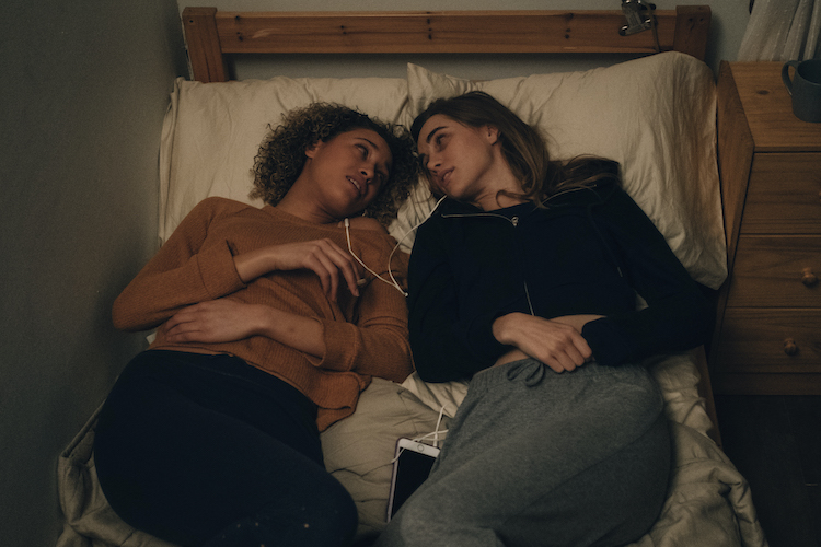 [L-R] Ella-Rae Smith as Helina and Suki Waterhouse as Camille in the horror SEANCE, an RLJE Films and Shudder release. Photo courtesy of RLJE Films and Shudder.