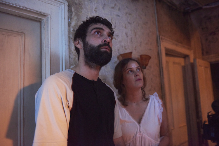 Alec Secareanu and Carla Juri in AMULET, a Magnet release. © Rob Baker Ashton. Photo courtesy of Magnet Releasing.