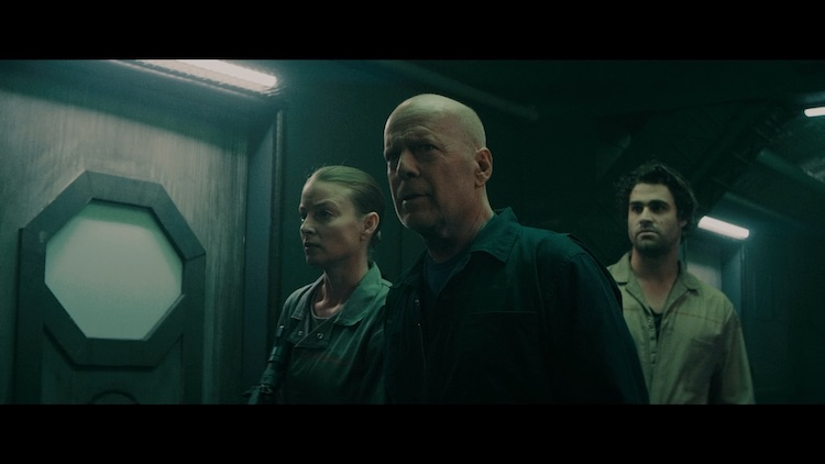 (L - R) Rachel Nichols as Chambers, Bruce Willis as Clay Young, and Cody Kearsley as Noah in the sci - fi/action film , BREACH , a Saban Films release. Photo courtesy of Saban Films.