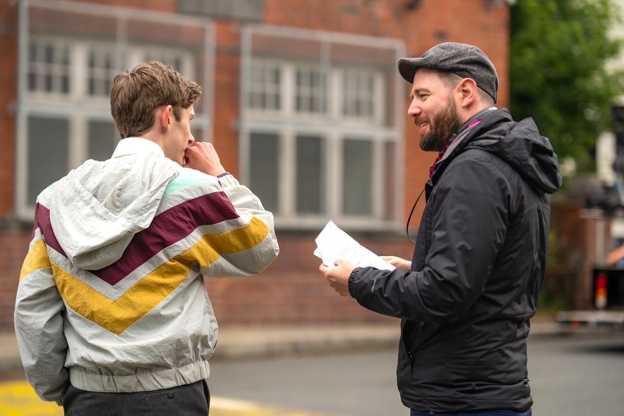 (L - R) Fionn O'Shea and writer/director, David Freyne , behind the scenes in the Comedy/ LGBTQ /Romance/Drama , DATING AMBER , a Samuel Goldywn Films release. Photo courtesy of Samuel Goldwyn Films