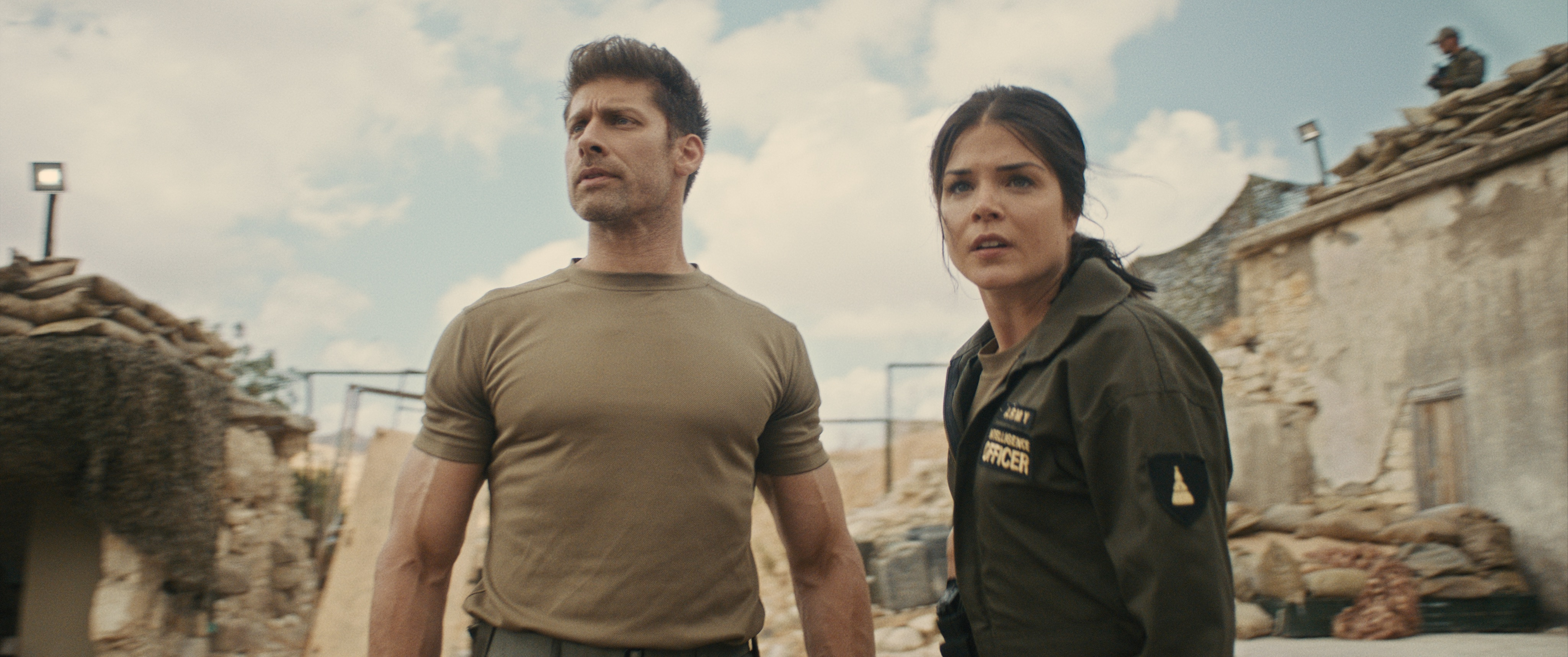 (L - R) Alain Moussi as Jake and Marie Avgeropoulos as Myra in the action/sci - fi film, JIU JITSU , The Avenue release. Photo courtesy of The Avenue