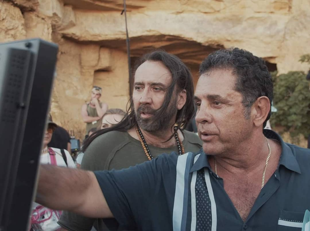 (L - R) Nicolas Cage and director Dimitri Logothetis behind the scenes of the action/sci - fi film, JIU JITSU , a The Avenue release. Photo courtesy of The Avenue