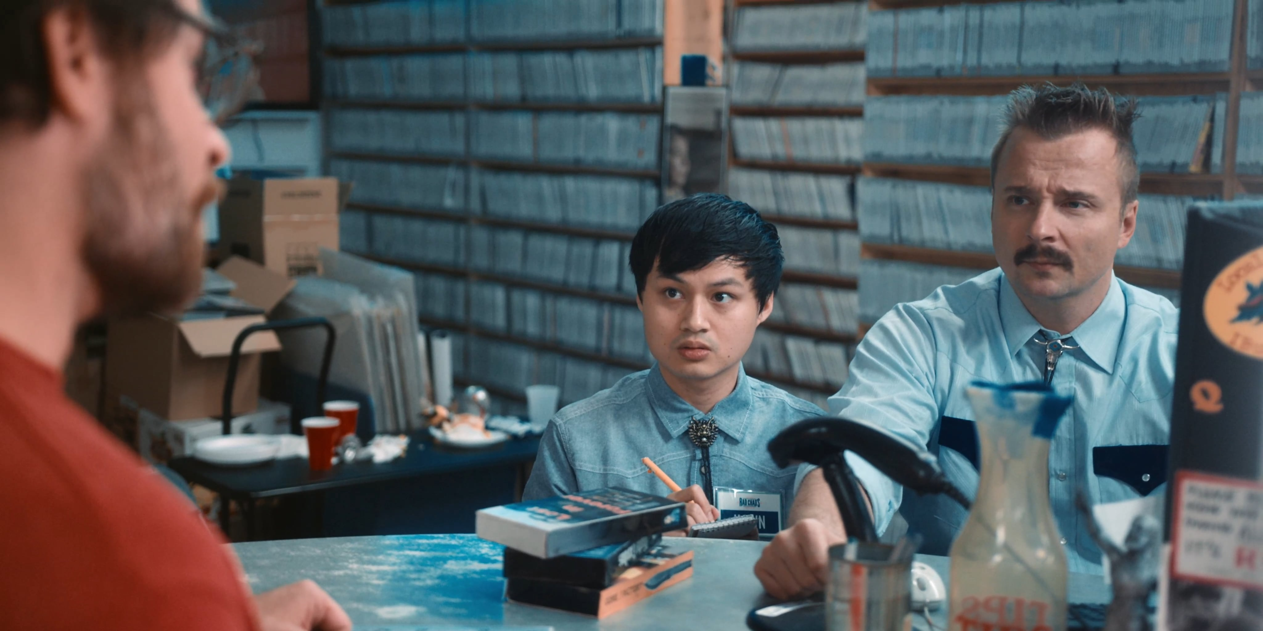 """(L - R) Hawn Tran as Hawn and Jeremy King as Chad Buckley in the horror/comedy """" SCARE PACKAGE , """" a Shudder a nd RLJE F ilms release. Photo courtesy of Shudder and RLJE Films"""