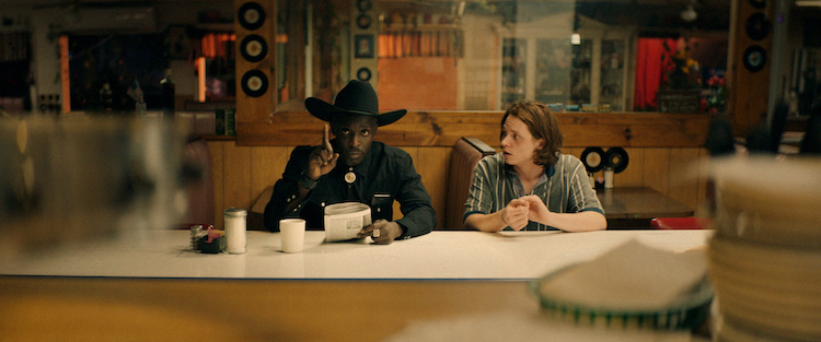 [L - R] Michael Kenneth Williams as Wood and Jack Kilmer as Utah in the thriller BODY BROKERS , a Vertical Entertainment release. Photo courtesy of Vertical Entertainment.