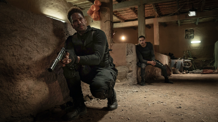 (L - R) Gary Dourdan as Brad Paxton and Brice Bexter as Youne s Laalej in the action film REDEMPTION DAY , a Saban Films release. Photo courtesy of Saban Films