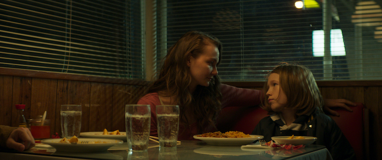 [L - R] Andi Matichak as Laura and Luke David Blumm as D avid in the horror film SON , a RLJE Films/Shudder release. Photo courtesy of RLJE Films.
