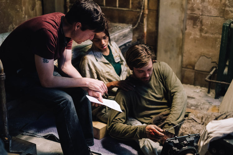 [L-R] Director, Jonathan W. Stokes, Georgina Campbell as Khadija Young, and Luke Benward as Luke White behind the scenes of the thriller WILDCAT, a Saban Films release. Photo courtesy of Saban Films.